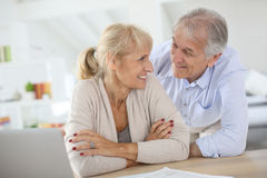 Happy senior couple laughing at home Royalty Free Stock Photo