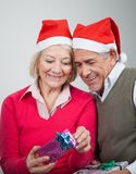 Happy Senior Couple Looking At Christmas Gifts Royalty Free Stock Photo