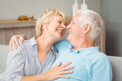 Happy senior couple looking at eachother while hugging Royalty Free Stock Photography