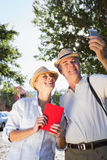 Happy senior couple looking at smartphone Royalty Free Stock Photo