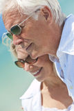 Happy Senior Couple Looking To Sea on a Beach Royalty Free Stock Images