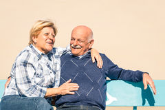 Happy senior couple in love at the beach - Joyful elderly lifestyle. Happy senior couple in love having fun at the beach - Joyful elderly lifestyle with men and Royalty Free Stock Photography