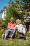 Happy senior couple in love relaxing together in the garden royalty free stock photo