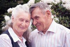 Happy senior couple lying in spring park. Stock Image