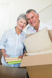 Happy senior couple moving into new home Stock Images