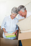Happy senior couple moving into new home Stock Photography