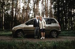 Happy senior couple with new car stock photography