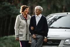 Happy senior couple with new car royalty free stock photo