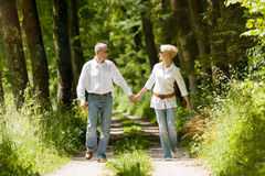 Happy senior couple outdoors running Stock Photo