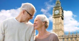 Happy senior couple over big ben tower in london Stock Photo