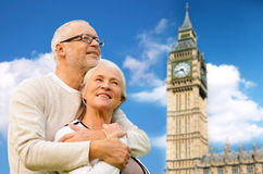 Happy senior couple over big ben tower in london Stock Image