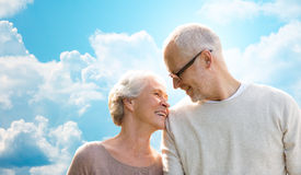 Happy senior couple over blue sky and clouds Royalty Free Stock Photos
