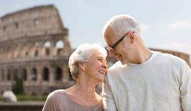Happy senior couple over coliseum in rome, italy Royalty Free Stock Image