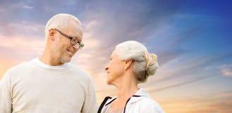 Happy senior couple over evening sky Stock Photo