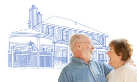 Happy Senior Couple Over House Drawing on White. Background royalty free stock photo