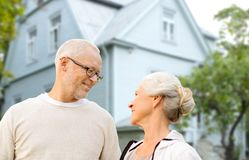 Happy senior couple over living house background Stock Photography