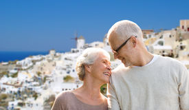 Happy senior couple over santorini island Stock Photo