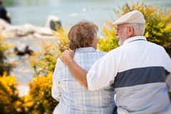 Happy Senior Couple in The Park Stock Images