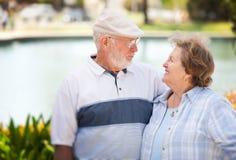 Happy Senior Couple in The Park Stock Image