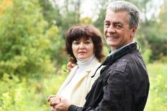 Happy senior couple in a park. Happy senior couple in a autumn park Royalty Free Stock Photos