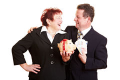 Happy senior couple with piggy bank Royalty Free Stock Images
