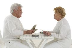 Happy senior couple playing cards game Stock Photography