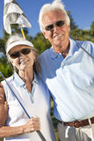 Happy Senior Couple Playing Golf Together. Happy senior men and women couple together playing golf royalty free stock images