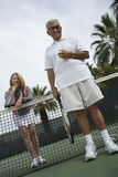 Happy Senior Couple Playing Tennis Royalty Free Stock Image