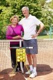 Happy senior couple playing tennis Stock Image