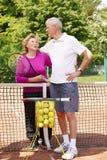 Happy senior couple playing tennis Royalty Free Stock Image