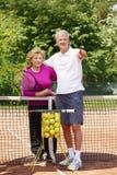 Happy senior couple playing tennis Royalty Free Stock Photo