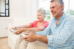 Happy senior couple playing video games Royalty Free Stock Image