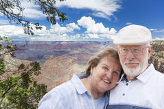 Happy Senior Couple Posing on Edge of The Grand Canyon Stock Photography