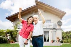 Happy Senior Couple Raising Their Arms Royalty Free Stock Photography