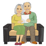 Happy senior couple reading letter together Royalty Free Stock Photos