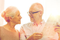 Happy senior couple reading newspaper at home Royalty Free Stock Photo