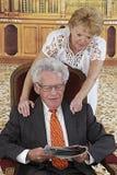 Happy senior couple in reading room Royalty Free Stock Photography