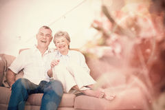 Happy senior couple relaxing on sofa Stock Image