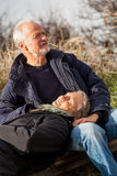 Happy senior couple relaxing together in the sunshine stock photography