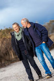 Happy senior couple relaxing together in sunshine stock photos