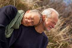 Happy senior couple relaxing together sunshine Stock Photos