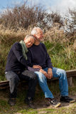 Happy senior couple relaxing together in sunshine Royalty Free Stock Image