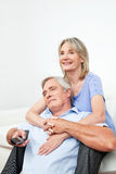 Happy senior couple with remote Royalty Free Stock Photos