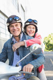 Happy senior couple riding a moped royalty free stock images