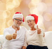 Happy senior couple in santa helper hats Stock Images