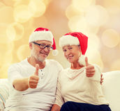 Happy senior couple in santa helper hats Stock Image