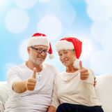 Happy senior couple in santa helper hats Stock Photos