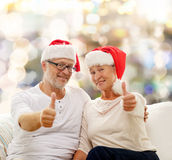 Happy senior couple in santa helper hats Royalty Free Stock Image
