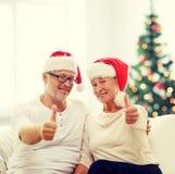 Happy senior couple in santa helper hats Stock Photo