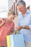 Happy senior couple shopping in the city Royalty Free Stock Photography